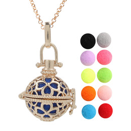 $enCountryForm.capitalKeyWord Australia - Gold Color Four Leaf Clover Flower Lava Beads Cage Essential Oil Pendant Diffuser Ball Angel Bola Chime Ball Charms With Chain Making