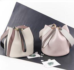 $enCountryForm.capitalKeyWord Australia - 2019 new leather stylish cross-body bag bucket bag matching color single-shoulder cross-body bag for women