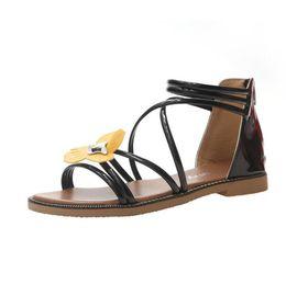 SandalS flower covering toe online shopping - New summer wild casual wild open toe flat cross straps flowers sandals Roman beach shoes women