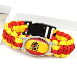 Camp Charms Australia - Wholesale Red Yellow Braided Umbrella Rope Bangles Glass Convex Ellipse Spain National Flag Outdoor Camping Survival Paracord Charm Bracelet