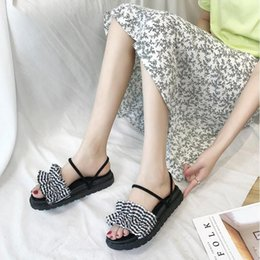 Wholesale Two wearing sandals female students summer Korean version of the bear shoes flat bottom wild beach holiday slippers women