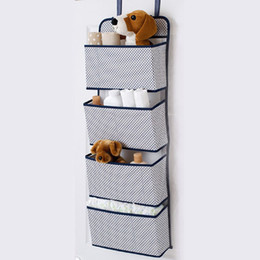China Multilayer Babies Disposable Diaper Storage Bag Baby Crib Hanging Bag Newborn Baby Bottle Organizer Baby Feeding Bottle Holder suppliers