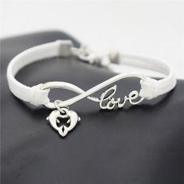 $enCountryForm.capitalKeyWord NZ - Boho Infinity Love Double Dolphin Heart Animal Pendant Bracelets Women Men Fashion Accessories Handmade White Leather Suede Rope DIY Jewelry