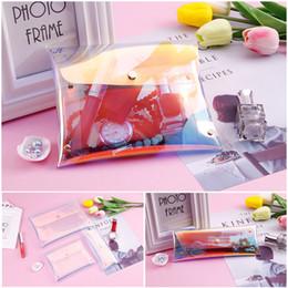 Venta al por mayor de Caliente nueva moda mujer botón maquillaje bolsa flash láser holográfico monedero lápiz papelería casos bolsas multiusos
