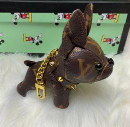 Alta calidad de lujo llavero de diseño clave de la hebilla del monedero colgante Bolsas Diseño del perro del estilo del bolso de la muñeca de las cadenas dominantes hebillas Louis Vuitton con la caja en venta