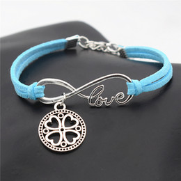 $enCountryForm.capitalKeyWord Australia - Vintage Braided Blue Leather Suede Bracelets for Men Women Infinity Love Round Carved Four Leaf Clover Flowers Charm Bracelets Drop Shipping