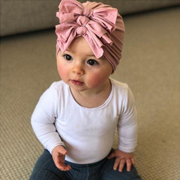 $enCountryForm.capitalKeyWord Australia - hot sales Children's hats, baby, autumn and winter, new soft knitted fabric, pleated bow, Indian hat, wholesale 5 pcs.