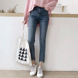 самые продаваемые джинсы оптовых-2019 Best selling explosions new jeans women s high waist Korean version of the torn edge was thin nine points feet pants