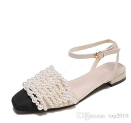 beach sexy cloth Australia - women Summer Pearl sandals classic fashion brand Sexy Genuine Leather Soft beach banquet women Lace-up beaded stitching sandals