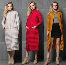 White extra long coat online shopping - Extra long down jacket women s over the knee coat white duck down stand collar light down jacket autumn and winter new coat SH190930