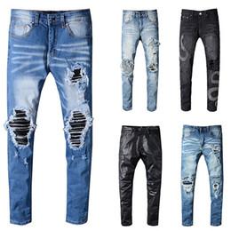 e3b0e3fd3f Ocio marca de calidad superior famoso diseño jeans hombres ripped elegante  biker jeans estilo rock sólido rojo recto jeans de los hombres venta  caliente