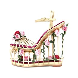 China Brand Unique Style Metal Gold Caged High Platform Wedge Sandals Cut-out Flowers Decoration Ankle Strap Super High Wedge Sandals cheap caged gladiator sandals suppliers
