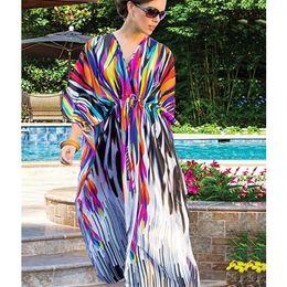 b9781dfc58 Beach Dresses Women Loose Long Maxi Dress Bikini Cover Up Printed Bohemia  Loose Swimsuit Cape Summer 2019 New Women s Tunic