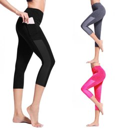 yoga pants pockets Canada - Push Up Yoga Pants Women's Side Pocket Stitching Tight Running Stretch Seven-point Yoga Pants Large size night running#N