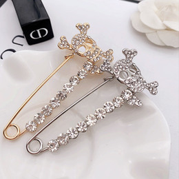 $enCountryForm.capitalKeyWord Australia - New designer female rhinestone skull head word collar brooch high quality brand brooch jewelry gift love accessories fast delivery
