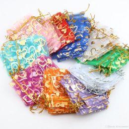 Venta al por mayor de 100 unids Organza Wedding Gift Gift Bag 70x90 mm Organza Wedding Party Regalo Bolsas de joyería Bolsas