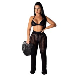 Chinese  women sets summer knitted hollow out halter neck bra top straight pants suit two piece set sexy party tracksuit outfit manufacturers