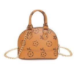 $enCountryForm.capitalKeyWord NZ - New European and Korean old flower shell coin purse key bag Messenger bag chain children's princess bag 117