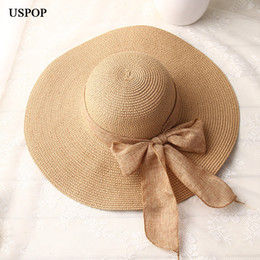 68e652f5004f6 Uspop 2019 Fashion Women Sun Hats Hand Made Straw Female Ribbon Bow-knot  Wide Brim Beach Hat Casual Summer Shade Anti Uv Cap C19041201