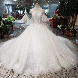 appliques style wedding dresses NZ - 2019 Newest Style Lebanon Sexy Wedding Dresses Illusion High Collar Shining Beaded Wedding Gowns Heart-shaped Open Keyhole Back Bridal Gow