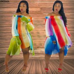 2019 nuova primavera estate femminile strisce arcobaleno spalla chiffon alto basso irregolare saum ginocchio lungo spiaggia allentata Hm6079 Y19071101 in Offerta