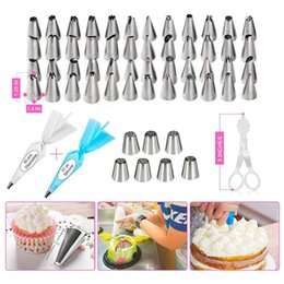 turntable cake decorating UK - 124 PCS Cake Decorating Kit Icing Tips Turntable Pastry Bags Couplers Cream Nozzle Baking Tools Set for Cupcakes Cookies Y200618