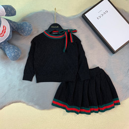 $enCountryForm.capitalKeyWord Australia - pleated skirts sets kids designer clothing cardigan sweater Girls + skirt 2pcs autumn and winter cotton line knit sets best