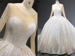 puffy real crystal wedding dress NZ - 2020 Glitter Crystal Ball Gown Wedding Dresses Jewel neck Long Sleeves Glitter Sequin Puffy Skirt Chapel Train Cheap Wedding Bridal Gowns