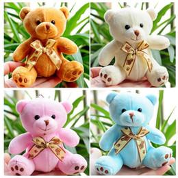 Venta al por mayor de 1 unids venta caliente 10 CM Kawaii pequeños osos de peluche juguetes de peluche animales de peluche mullido oso muñecas niños juguetes para niños pequeños llaveros colgante