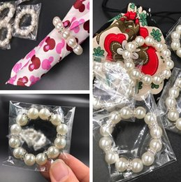 China 30Pcs Lot White Pearls Napkin Rings Wedding Napkin Buckle For Wedding Reception Party Table Decorations Supplies I121 supplier white pearl napkin ring suppliers