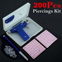 Venta al por mayor de Conjunto de pistola de piercing de oreja de seguridad Conjunto de pistola de piercing de oreja de ombligo conjunto con 200 unids Pendientes Studs para mujeres hombres