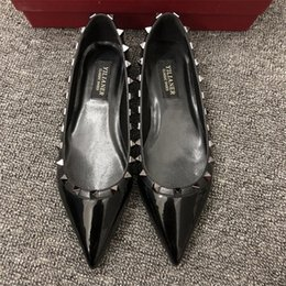 bride leather wedding shoes Australia - Free shipping fashion women Casual Designer black patent leather studded spikes poin toe flats shoes bride wedding shoes brand new