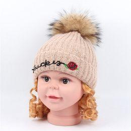 deab251556e Winter Beanie for Boys Girls Kids Wool Knitted Hats Warm Fleece Lined Knitting  Caps Flower Beanies Hat Real Raccoon Fur Pom Balls Cap