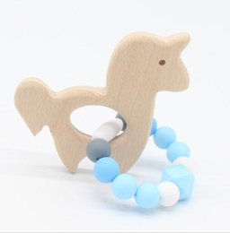 China Wooden Baby Bracelet Animal Shaped Jewelry Teething For Baby Organic Wood Silicone Beads Baby Rattle Stroller Accessories Toys cheap wooden baby rattles suppliers