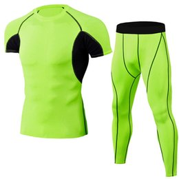 Compression short sizing online shopping - Brand New Compression Men S Sport Suits Quick Dry Solid Color Sets Clothes Sports Gyms Fitness Tracksuits Sets Size M XL