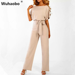 d2b676727dd Wuhaobo Short Sleeve 2019 New Women Jumpsuit Solid Back Button Bodysuits  Womens Casual Spring Summer Overalls Female Jumpsuits Y19042003