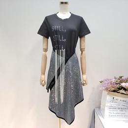 Drill T Shirt Australia - 2019 New Fashion Letter Tassel Short-sleeved T-shirt + Irregular Zipper Hot Drilling Skirt Female's 2 Pieces Set E056