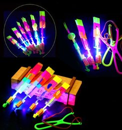 Rocket flying toy online shopping - New Amazing Flashing Led Arrow Rocket Helicopter Rotating Flying cs Light Up For Kids Party Decoration Gift