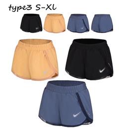 Short girlS yoga pantS online shopping - Women Sports Yoga Shorts NK Summer Gym Fitness Casual Short Pants Girls Running Curved Hem Shorts Elastic Lined Leisue Shorts Brand C73003