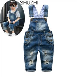 jeans jumpsuit kids Australia - SHUZHI New Spring Distrressed Hole Baby Boy Girl Jeans jumpsuit Kids Denim Overalls Fashion Children Ripped JeansMX190916
