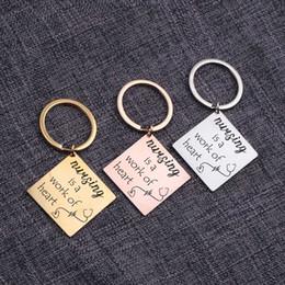 gold heart key pendant 2019 - Nursing Is A Work Of Heart Pendant Keychains Nurse Keepsake Keyrings Bag Charm Novelty Trinket Key Holder Accessories Br