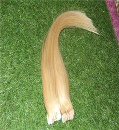 Cinta de color dorado rubio 100% en extensiones de cabello humano 10-30 pulgadas Remy Extensiones de cabello 10-30 pulgadas Piel de trama Extensión de cabello recto en venta