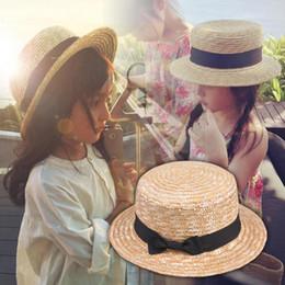 Straw Fedora Beach Hat Australia - Cute Child Girls Straw hat Bowknot Sun Hat Kids Large Brim Beach Summer Boater Beach Ribbon Round Flat Top fedora hat 54CM
