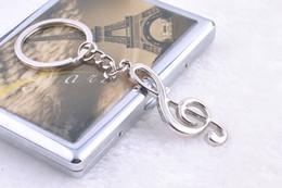 $enCountryForm.capitalKeyWord NZ - Originality Gift Personality Note Metal Key Buckle Automobile Advertisement Waist Hanging Music Symbol Key Ring Link Pendant