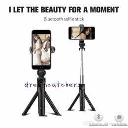 extendable handheld tripod NZ - Foldable Mini Bluetooth Selfie Stick Tripod Selfie Monopods Handheld Extendable Mini travelling photo camera For iphone Samsung Smartphone .
