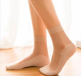 Ingrosso Sexy calze a rete a rete in pizzo Elasticità elasticizzata trasparente Calzini alla caviglia divertente Maglia sottile donne sottili Calze di seta lucide brillanti