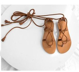Roman Style Sandals Shoes Flats NZ - 2019 spring and summer new beach sandals ladies Roman style women's shoes cross straps flat bottom strap