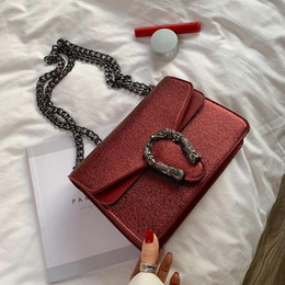 Sling Style handbagS online shopping - Factory brand women handbag flip leather small square bag fashion snake lock women slung shoulder bag Western style leather Dionys