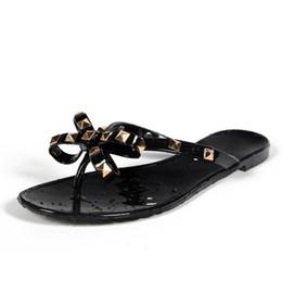 Summer Flip Flop Shoes Australia - 2019 European Summer New Fashion Rivet Slippers Bow Flat Flip Flops Women Wear Cool Beach Slippers Jelly Slides Garden Shoes