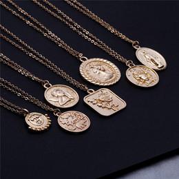1a5c1a54f7ca Collar de oro en relieve de plata grabado Rosa de la reina ángel Madonna  collar colgantes Collares de monedas de oro Joyería de moda Will y Sandy  380110